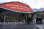 With local coronavirus lockdown measures in place and Birmingham currently set at 'Tier 2' or 'high', a digital board outside Grand Central station advises for people to wear a face covering while shopping in city centre on 26th October 2020 in Birmingham, United Kingdom. The three tier system in the UK has levels: 'medium', which includes the rule of six, 'high', which will cover most areas under current restrictions; and 'very high' for those areas with particularly high case numbers. Meanwhile there have been calls by politicians for a 'circuit breaker' complete lockdown to be announced to help the growing spread of the Covid-19 virus.