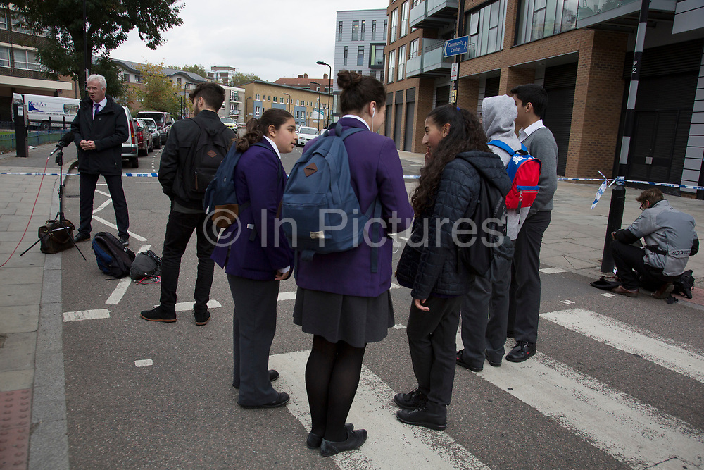Local children near to the crime scene where a male police officer was shot during a firearms operation in Scriven Street in the Haggerston area of Hackney. A specialist firearms unit and officers from Trident Area Crime Command, which is responsible for tackling gang crime, were conducting an operation in Scriven Street at the time of the shooting.