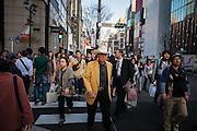 JAPAN, TOKYO, March 2013 - man wear a Stetson's hat and a yellow jacket on Saturday in Ginza [FR] homme porte un chapeau Stetson et une veste Jaune le Week end dans les rues de Ginza
