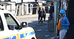 SOUTH AFRICA - Cape Town - 03 July  2020  - Khayelitsha Police officials on the crime scene near Kuwait Taxi rank where two men were gunned down.No one is sure about the details of the murder but the two men were shot in the car and one outside a Somali shop,the third men who was also shot was rushed to the nearby hospital . Picture: Phando Jikelo/African News Agency(ANA)