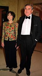 MR & MRS MARK LITTMAN, leading social figures,  at a dinner in London on 29th February 2000.OBS 70