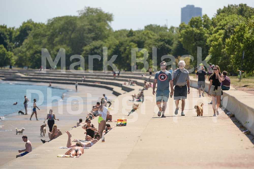 Chicagoans enjoy the weather along the shore of Lake Michigan in Chicago, Illinois on Friday, Sept. 4, 2020. Photo by Mark Black