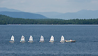 All lined up like ducks in a row as Lake Winnipesaukee Sailing Association heads out to open water Thursday afternoon.  (Karen Bobotas/for the Laconia Daily Sun)