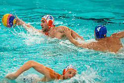 Guus van IJperen of the Netherlands in action against Andrei FuleaTudor of Romania during the Olympic qualifying tournament. The Dutch water polo players are on the hunt for a starting ticket for the Olympic Games on February 16, 2021 in Rotterdam