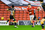 Kieffer Moore of Barnsley (19) flicks the ball past Nat Knight-Percival of Bradford City (22) during the EFL Sky Bet League 1 match between Barnsley and Bradford City at Oakwell, Barnsley, England on 12 January 2019.