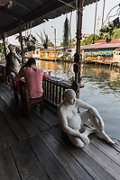 Bangkok Artists House - Artist's House orThai Baan Silapin - Long ago, these types of old Thai teak houses were very typical along the klongs but today are becoming rare, usually replaced by concrete buildings. Baan Silapin has been beautifully restored, with unusual features such as human statues sitting by the water, gazing at life passing by. Artist House is owned by Chumpol Akkapantanon - the house was run down when it was bought before being restored to its present glory. It's a great escape from the crazy traffic of Bangkok - it has beauty in its rustic sort of way with its own 600 year old chedi in the back yard. There is a coffee shop inside and tradtional puppet shows are performed every afternoon, using puppets from the famous Joe Louis theatre that was once held at the Suan Luan Bazaar.