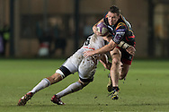 Adam Warren of the Newport Gwent Dragons is tackled by William Whetton of Brive as he runs towards the line. European Challenge cup pool 3 match, Newport Gwent Dragons v Brive, at Rodney Parade in Newport, South Wales on Friday 14th October 2016.<br /> pic by  Simon Latham, Andrew Orchard sports photography.