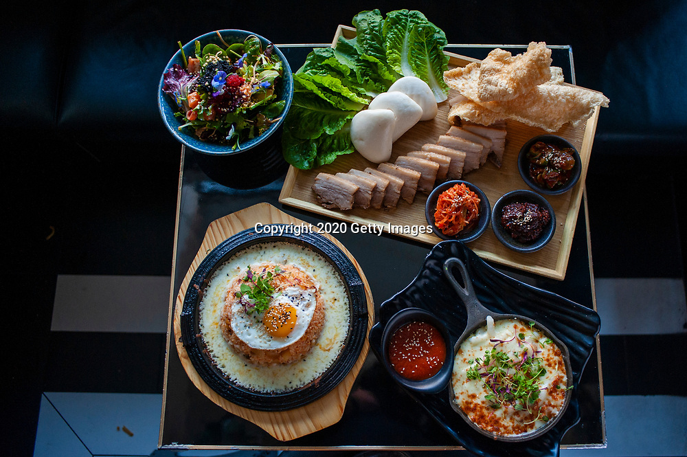 NEW YORK- JANUARY 09: Hanabi Salad, Tteok N' Cheese, Volcano Kimchi Fried Rice and Pork Belly Bossam Board photographed at Chef Esther Choi's My Soo on January 9th, 2020 in New York City. (Photo by Kris Connor/Getty Images for OK! Magazine)