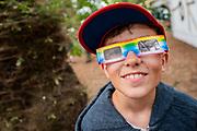 Henham Park, Suffolk, 19 July 2019. A boy enjoys glasses that create loads of rainbows in The Faraway Forest - The 2019 Latitude Festival.