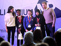 """© Licensed to London News Pictures. 08/03/2018. Birmingham, UK. MEGAN MARKLE and PRINCE HARRY pose for a photograph with young """"Stemettes"""" while attending Stemettes International Women's Day event in Birmingham, at  Millennium Point in Birmingham. Photo credit: Dave Warren/LNP"""