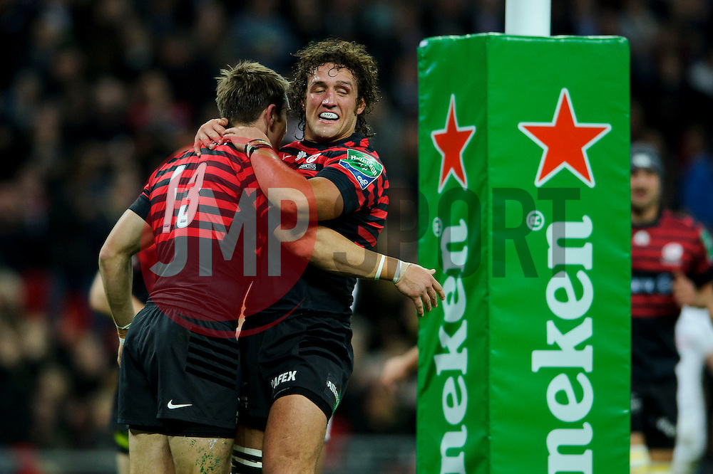 Saracens Outside Centre (#13) Chris Wyles celebrates scoring a try with Flanker (#7) Jacques Burger during the first half of the match - Photo mandatory by-line: Rogan Thomson/JMP - Tel: 07966 386802 - 18/10/2013 - SPORT - RUGBY UNION - Wembley Stadium, London - Saracens v Toulouse - Heineken Cup Round 2.