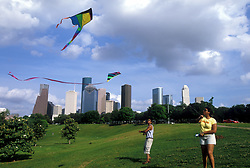 Stock photo of a man and woman flying kites in a  park near downtown Houston