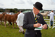 Judging heifers. The hairdryers are out and the shampoo is flowing at the Great Yorkshire Show, one of Britain's biggest agricultural shows. Its famous for its competitive displays of livestock. The event, established in 1837, attracts over 125 000 visitors a year and has over 10 000 entries to its pedigree competitions ranging from pigeons and rabbits to bulls and shire horses..At the heart of the show is the passion of the exhibitors who spend hundreds of hours ( and pounds)  training, preparing and grooming their animals. As one competitor put it ? I'm proud to say that the cattle are my friend, I have had cattle who have died and I have sat down and wept for them?