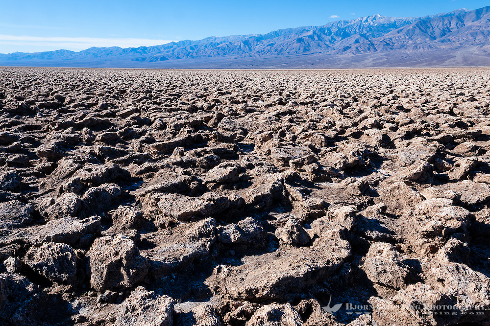 United States, California, Death Valley. The Devil's Golf Course is a large salt pan on the floor of Death Valley, with minerals left behind when the lake evaporated.