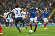 Portsmouth Midfielder, Gareth Evans (26) is first to the ball during the EFL Sky Bet League 1 match between Portsmouth and Wycombe Wanderers at Fratton Park, Portsmouth, England on 22 September 2018.