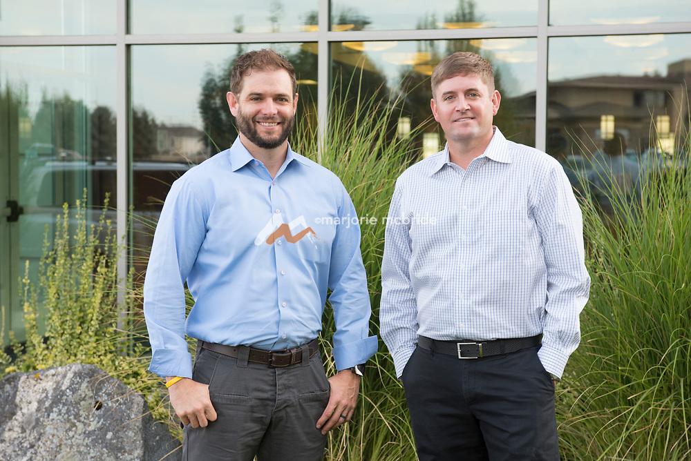 Jacob Florence left in blue shirt beside JJ McBride right in white shirt standing outside work in Twin Falls Idaho at Hub International Insurance.
