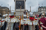 Roman guards get briefed by their centurion at tthe foot of Nelsons Column - The Wintershall Players open-air re-enactment of 'The Passion of Jesus' on Good Friday in the rain in Trafalgar Square. It featured a cast of over 100 volunteers from in and around London.