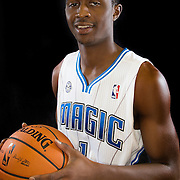 Doron Lamb poses in front of a backdrop during the Orlando Magic media day event at the Amway Arena on Monday, September 30, 2103 in Orlando, Florida. (AP Photo/Alex Menendez)