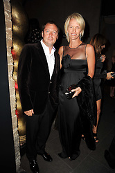 MATTHEW FREUD and ELISABETH MURDOCH at The Love Ball hosted by Natalia Vodianova and Lucy Yeomans to raise funds for The Naked Heart Foundation held at The Round House, Chalk Farm, London on 23rd February 2010.