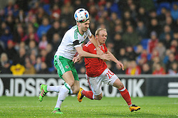 Gareth McAuley of Northern Ireland chases down the ball with Jonathan Williams of Wales - Mandatory by-line: Dougie Allward/JMP - Mobile: 07966 386802 - 24/03/2016 - FOOTBALL - Cardiff City Stadium - Cardiff, Wales - Wales v Northern Ireland - Vauxhall International Friendly