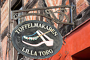 Lilla Torg clog and shoe maker shop in old town square in Malmo, Sweden