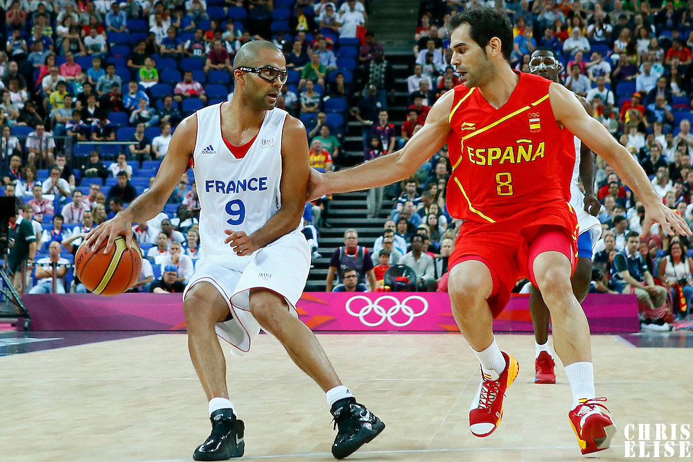 08 August 2012: France Tony Parker drives past Spain Jose Calderon during 66-59 Team Spain victory over Team France, during the men's basketball quarter-finals, at the 02 Arena, in London, Great Britain.