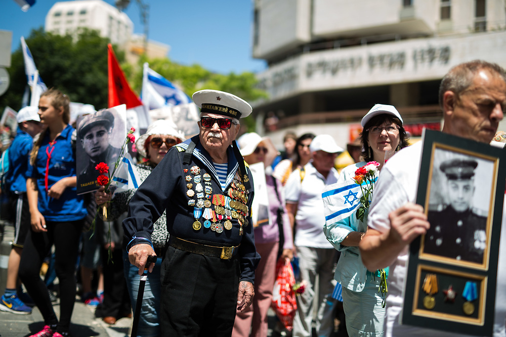 World War II veterans and Israelis march in central Jerusalem, Israel, on May 8, 2016, as they mark VE (Victory in Europe) Day, commemorating the 70th anniversary of the victory by the Allied forces over Nazi Germany during World War II.