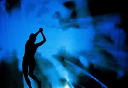 05.05.2011, Ferry Porsche CONGRESS CENTER, Zell am See, AUT, IRONMAN 70.3 Salzburg, im Bild eine weibliche Silhouette beim tanzen, blau Schattenspiele während der Präsentations- Pressekonferenz des Ironman 70.3 Zell am See Kaprun, der am 26. August 2012 erstmals über die Bühne geht // a female silhouette dancing, blue, EXPA Pictures © 2011, PhotoCredit: EXPA/ J. Feichter