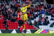 Sunderland forward Kazaiah Sterling (26), on loan from Tottenham Hotspur,  battles with Wimbledon defender Terell Thomas (6) during the EFL Sky Bet League 1 match between Sunderland and AFC Wimbledon at the Stadium Of Light, Sunderland, England on 2 February 2019.