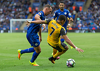 Football - 2016/2017 Premier League - Leicester Ciity V Arsenal. <br /> <br /> Alexis Sanchez of Arsenal takes a tumble after a challenge from Daniel Drinkwater of Leicester City at The King Power Stadium.<br /> <br /> COLORSPORT/DANIEL BEARHAM