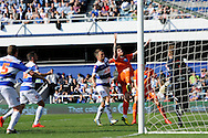 Blackpool's David Goodwillie heads the ball to score the first goal for Blackpool .Skybet football league championship match , Queens Park Rangers v Blackpool at Loftus Road in London  on Saturday 29th March 2014.<br /> pic by John Fletcher, Andrew Orchard sports photography.