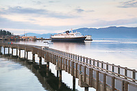 Alaska Ferry approaching dock in Bellingham Bay, from Boulevard Park Boardwalk, Bellingham Washington