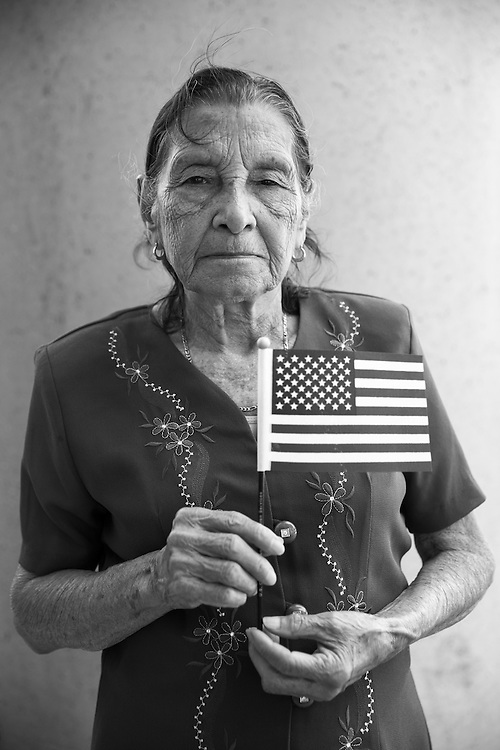 New American: Maria Murcia, 81, naturalized as a US Citizen moments earlier, registered with the Democratic Party. Planned to vote in the 2016 election.