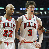 26 March 2012: Chicago Bulls forward Taj Gibson (22) and Chicago Bulls center Omer Asik (3) are seen during the Denver Nuggets 108-91 victory over the Chicago Bulls at the United Center, Chicago, Illinois, USA. NOTE TO USER: User expressly acknowledges and agrees that, by downloading and or using this photograph, User is consenting to the terms and conditions of the Getty Images License Agreement. Mandatory Credit: 2012 NBAE (Photo by Chris Elise/NBAE via Getty Images)