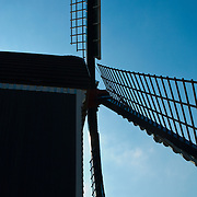 Close-up of windmill against blue sky