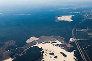 Nederland, Gelderland, Gemeente Nunspeet, 06-09-2010; noordelijk deel Gelderse Veluwe, gezien naar het westen (richting Harderwijk). De weg is de A28. .Northern Veluwe, seen to the 'border lakes' between the old and new land..luchtfoto (toeslag), aerial photo (additional fee required).foto/photo Siebe Swart