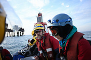 Greenpeace activists get ready to board the cargo ship at sea  September 21st 2017, Thames Estuary, Kent, United Kingdom. Greenpeace volunteers in kayaks, speed boats and climbers on the jetty prevent the 23,498-tonne cargo ship Elbe Highway from docking at Sheerness in Kent.  The cargo ship is bringing Volkswagen diesel cars into the UK and the Greenpeace action is to prevent this from happening and to make VW ditch diesel. Two climbers board the ship and hang a banner on the roll-on roll-off part of the ship preventing any cars from being off-loaded. The action is part of a long running Greenpeace campaign to curb diesel emmissions and air pollution brought on by diesel cars.