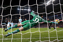 West Ham United's Angelo Ogbonna (left) scores his side's first goal of the game during the Premier League match at the Etihad Stadium, Manchester.