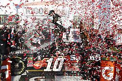 October 14, 2018 - Talladega, Alabama, United States of America - Aric Almirola (10) celebrates in Victory Lane after winning the 1000Bulbs.com 500 at Talladega Superspeedway in Talladega, Alabama. (Credit Image: © Chris Owens Asp Inc/ASP via ZUMA Wire)