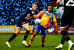 Mattie Pollock of Grimsby Town and Nicky Maynard of Mansfield Town tussle for the ball - Mandatory by-line: Ryan Crockett/JMP - 04/01/2020 - FOOTBALL - One Call Stadium - Mansfield, England - Mansfield Town v Grimsby Town - Sky Bet League Two