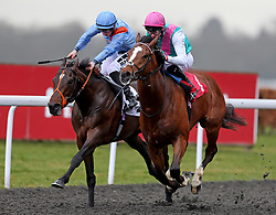 Crossed Baton ridden by Robert Havlin wins ahead of the Matchbook Betting Exchange EBF Novice Stakes Tigre du Terre ridden by Tom Marquand during the Easter Family Fun Day at Kempton Park Racecourse.