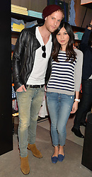 JACK FOX and GEMMA CHAN at a party to celebrate the reopening of the Lacoste Premium Store at 233 Regent Street, London on 28th May 2014.