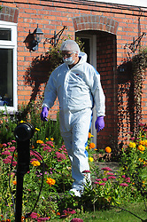 © Licensed to London News Pictures. 29/09/2018<br /> HADLOW, UK.<br /> Police forensics outside number 24 Carpenters Lane.<br /> A murder investigation has been launched in Hadlow,Kent after the deaths of two women at Carpenters Lane. A 28 year old man has been arrested on suspicion of murder after three people suffered serious injuries. Police forensic officers are at the scene inside two properties 26 and 24 Carpenters Lane.<br /> Photo credit: Grant Falvey/LNP