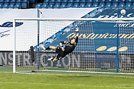 Barnsley goalkeeper Jack Walton (13) saves a shot from Queens Park Rangers midfielder Eberechi Eze (10) (not in picture) during the EFL Sky Bet Championship match between Queens Park Rangers and Barnsley at the Kiyan Prince Foundation Stadium, London, England on 20 June 2020.