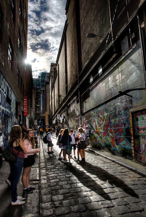Sunny Melbourne / Modern Melbourne. School kids enjoy Hosier Lane.Pic By Craig Sillitoe CSZ/The Sunday Age.9/05/2012 melbourne photographers, commercial photographers, industrial photographers, corporate photographer, architectural photographers, This photograph can be used for non commercial uses with attribution. Credit: Craig Sillitoe Photography / http://www.csillitoe.com<br /> <br /> It is protected under the Creative Commons Attribution-NonCommercial-ShareAlike 4.0 International License. To view a copy of this license, visit http://creativecommons.org/licenses/by-nc-sa/4.0/.