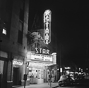 """Y-541124-3.  Night view of Star Theatre, on NW 6th between Burnside and Couch. Marquee says """"Featuring Bonita Secret in Manhaten Revue""""  November 24, 1954"""