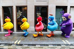 © Licensed to London News Pictures. 20/11/2016. London, UK. Performers dressed as cartoon mascots make their way to Regent Street as over 400 cast members get ready to participate in Hamley's Toy Parade, which marches along Regent Street in London in a colourful extravaganza, with marching bands, dancers and toy vehicles. Photo credit: Tolga Akmen/LNP