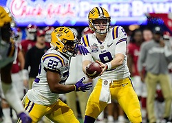 LSU Tigers quarterback Joe Burrow (9) prepares to hand the ball off to LSU Tigers running back Clyde Edwards-Helaire (22) during the first half against Oklahoma Sooners in the 2019 College Football Playoff Semifinal at the Chick-fil-A Peach Bowl on Saturday, Dec. 28, in Atlanta. (Vasha Hunt via Abell Images for the Chick-fil-A Peach Bowl)
