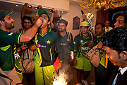 Pakistan National Cricket captain Shahid Afridi together with best friend and team mate Abdul Razzaq  and surrounded by other members celebrate their team's win against Zimbabwe during the group stages of 2011 ICC World Cricket Cup. Seen here joking and celebrating a moment of joy late in the evening after having returned from Pallakele Stadium, Kandy, Sri Lanka.