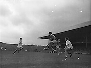 GAA All Ireland Minor Football Final Cork v. Galway 26th September 1960 Croke Park..D.Moynihan (no. 14) Cork full forward gains possession of the ball near the Galway Goalmouth with M. Tierney, Galway full back on the right ..26.9.1960  26th September 1960